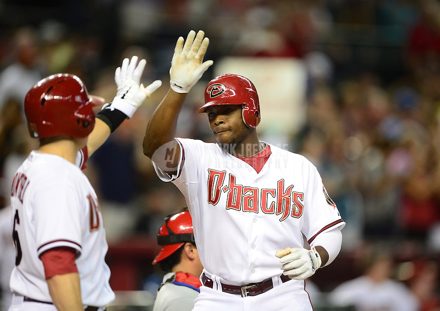 Apr. 23, 2012; Phoenix, AZ, USA; Arizona Diamondbacks outfielder Justin Upton (right) is congratulated by catcher Miguel Montero after hitting a solo home run against the Philadelphia Phillies in the fourth inning at Chase Field. Mandatory Credit: Mark J. Rebilas-