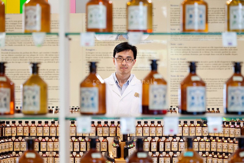 "Siliang Guo, a junior parfumeur, poses for the photographer at ""Le Studio des Fragrances"" of the Galimard perfume factory and visitor centre, Grasse, France, 3 May 2013."