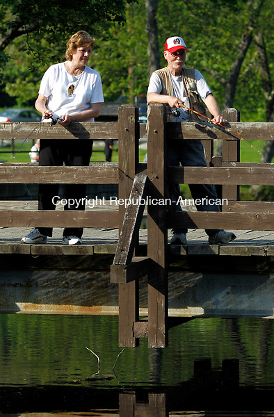 Southbury, CT- 27, May 2011-052711CM02 Nancy and Joe Carrafiello, of Seymour try their luck fishing at Soutford Falls in Southbury Friday afternoon.   The number of fishing licenses sold in CT has been on a decline this year.  Christopher Massa Republican-American