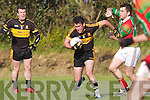 Dr Corokes Ambrose O'Donovan shows determination as he breaks free of the challenge from St Michaels/Foilmores Sean O'Shea at the Senior County Championship clash in Ballinskelligs on Saturday evening last.