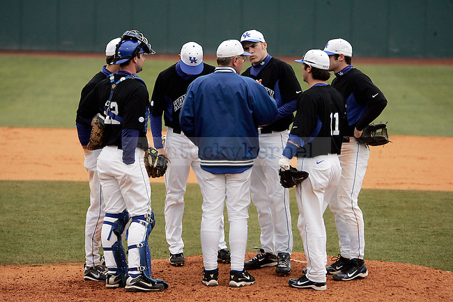 The UK men's baseball team talks with head coach Gary Henderson during the third inning of UK's win over Morehead State at Cliff Hagan Stadium on Tuesday, March 2, 2010. Photo by Britney McIntosh | Staff