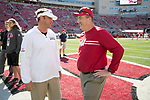 Wisconsin Badgers Head Coach Paul Chryst, right, talks to Florida Atlantic Owls Head Coach Lane Kifflin prior to an NCAA College Football game Saturday, September 9, 2017, in Madison, Wis. The Badgers won 31-14. (Photo by David Stluka)