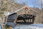 Snow-covered Albany Covered Bridge in the White Mountain National Forest, NH