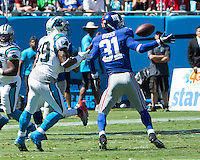 The Carolina Panthers played the New York Giants at Bank of America Stadium in Charlotte, NC.  The Panthers won 38-0 for their first victory of the season.  The Giants dropped to 0-3.  Carolina Panthers wide receiver Steve Smith (89) catches a pass as New York Giants cornerback Aaron Ross (31) defends