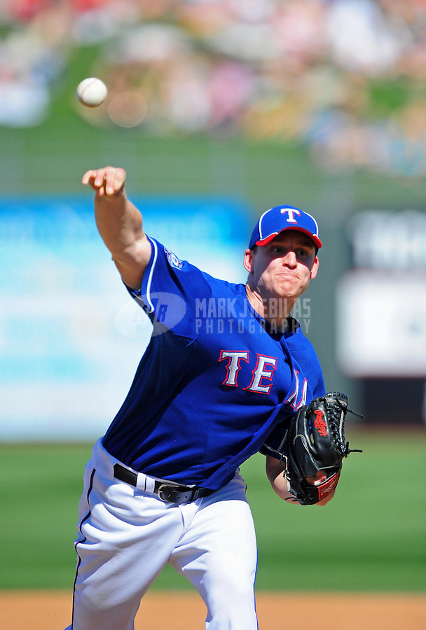 Mar. 15, 2012; Surprise, AZ, USA; Texas Rangers pitcher Neil Ramirez throws in the fourth inning against the Oakland Athletics at Surprise Stadium.  Mandatory Credit: Mark J. Rebilas-