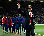 A down looking Louis van Gaal manager of Manchester United waves to the fans as his substitutes shuffle along behind him - English Premier League - Manchester Utd vs Chelsea - Old Trafford Stadium - Manchester - England - 28th December 2015 - Picture Simon Bellis/Sportimage