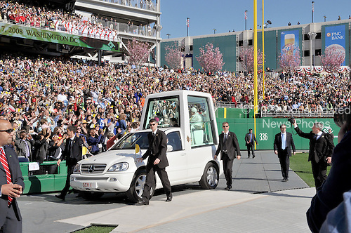Washington, DC - April 17, 2008 -- Pope Benedict XVI waves to the crowd as he arrives in in the Popemobile to Nationals Park to celebrate Mass in Washington, D.C. on Thursday, April 17, 2008. This is the first non-baseball event in the park, which opened March 31..Credit: Ron Sachs / CNP.(RESTRICTION: NO New York or New Jersey Newspapers or newspapers within a 75 mile radius of New York City)