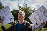 © Joel Goodman - 07973 332324 . No syndication permitted . 26/08/2013 . Bolton , UK . A Unite Against Fascism supporter opposing the EDL demonstration . The English Defence League hold a demonstration in Farnworth Park , Bolton , today (26th August 2013) . Photo credit : Joel Goodman