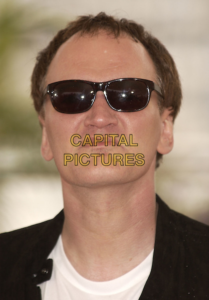QUENTIN TARANTINO.Photocall for the Jury of.Cannes Film Festival, France 12 May 2004.portrait headshot sunglasses funny face sneer.sales@capitalpictures.com.www.capitalpictures.com.©Capital Pictures