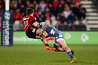 25th July 2020, Christchurch, New Zealand;  George Bridge of the Crusaders is tackled by Ben Lam of the Hurricanes during the Super Rugby Aotearoa, Crusaders versus Hurricanes at Orangetheory stadium, Christchurch