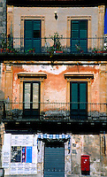 Detail of an apartment building in Ragusa, Sicily, Italy.