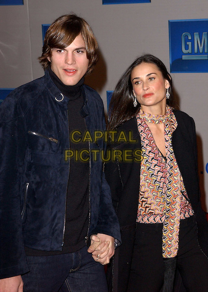 "ASHTON KUTCHER & DEMI MOORE.3rd Annual GM ""Ten"" fashion show and charity event to celebrate award season and car culture held at Sunset and Vine in the heart of Hollywood .24 February 2004                                                                  *UK Sales Only*                                                             .half length, half-length, holding hands, geometric print top.www.capitalpictures.com.sales@capitalpictures.com.©Capital Pictures."