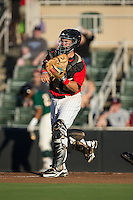 Kannapolis Intimidators catcher Brett Austin (20) makes a throw to third base following a strikeout against the Greensboro Grasshoppers at CMC-Northeast Stadium on August 1, 2015 in Kannapolis, North Carolina.  The Intimidators defeated the Grasshoppers 7-4.  (Brian Westerholt/Four Seam Images)
