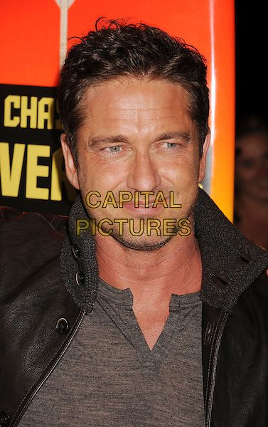 Gerard Butler.Special Screening of 'Chasing Mavericks' held at The Pacific Grove Stadium 14 in Los Angeles, California, USA..October 18th, 2012.headshot portrait brown leather jacket grey gray top stubble facial hair  .CAP/ROT/TM.©Tony Michaels/Roth Stock/Capital Pictures