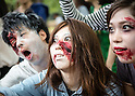 May 16, 2015, Tokyo, Japan - In this photo released on May 17, 2015, shows participants dressed as zombies walking through Tokyo's Yoyogi Park. The walk takes place annually where hundreds of zombie maniacs gather to dress up in zombie costumes. (Photo by AFLO)