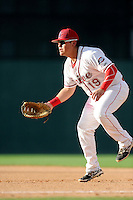 First baseman Francisco Tellez (48) of the Greenville Drive plays the infield in a game against the Savannah Sand Gnats on Sunday, July 5, 2015, at Fluor Field at the West End in Greenville, South Carolina. Savannah won, 8-6. (Tom Priddy/Four Seam Images)