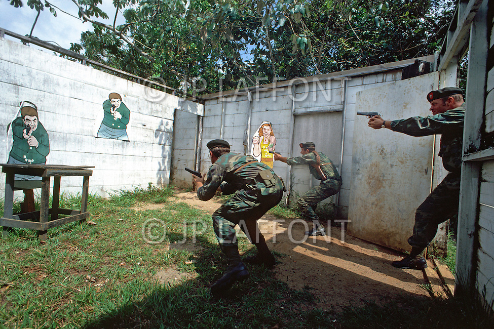 Special Force, April 1982. Members of the 3rd Batallion, 7th Special Force Group (Airborne). Conducting a counter-urban guerrila excersice at Fort Davis, Panama.