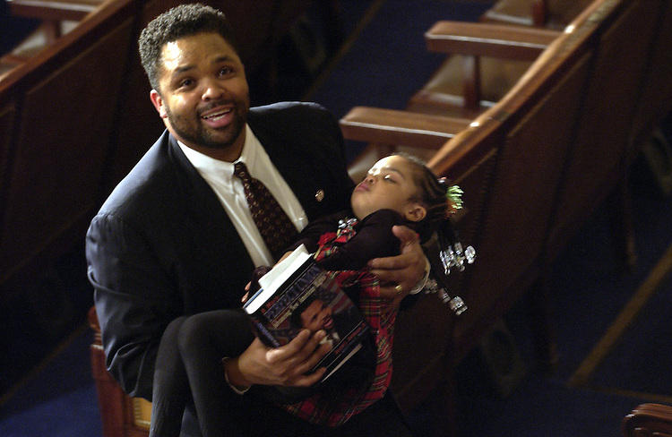 Jesse L. Jackson Jr., D-Il., and his sleeping daughter Jessica Jackson after the State of the Union address. Jessica is 3 years old.