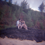 Couple hugging on rocks at beach