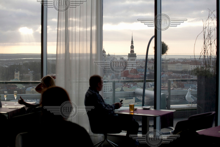 People in the Sky Lounge at the Radisson Blu hotel which has views over the old town.