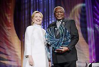 Former United States Secretary of State Hillary Clinton, the 2016 Democratic Party nominee for President of the United States, receives the Phoenix Award from US House Assistant Democratic Leader Jim Clyburn (Democrat of South Carolina) during the Congressional Black Caucus Foundation's 46th Annual Legislative Conference Phoenix Awards Dinner at the Washington Convention Center, September 17 2016, in Washington, DC. <br /> Credit: Olivier Douliery / Pool via CNP /MediaPunch /MediaPunch