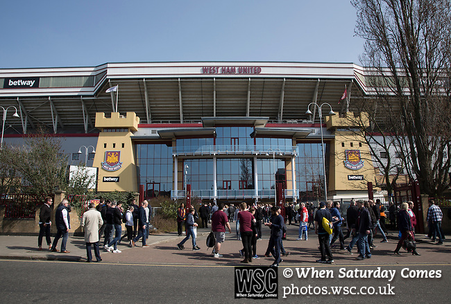 West Ham United 2 Crystal Palace 2, 02/04/2016. Boleyn Ground, Premier League. Fans arriving outside the Betway Stand at the Boleyn Ground before West Ham United hosted Crystal Palace in a Barclays Premier League match. The Boleyn Ground at Upton Park was the club's home ground from 1904 until the end of the 2015-16 season when they moved into the Olympic Stadium, built for the 2012 London games, at nearby Stratford. The match ended in a 2-2 draw, watched by a near-capacity crowd of 34,857. Photo by Colin McPherson.