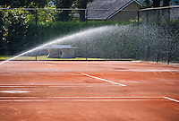 Etten-Leur, The Netherlands, August 23, 2016,  TC Etten, NVK, Clay Tennis court is being watered by automatic sprinklers<br /> Photo: Tennisimages/Henk Koster