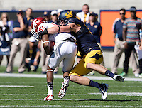 Lucas King of California tackles Bobby Ratliff of Washington State during the game at Memorial Stadium in Berkeley, California on October 5th, 2013.  Washington State defeated California, 44-22.