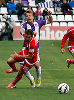 Real Valladolid´s Ebert (back) against Sevilla´s Navarro (front) during La Liga match. March 28, 2010. (ALTERPHOTOS/Víctor J Blanco)