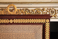 "Detail of fire screen, 1806, Jacob-Desmalter, mahogany and ormolu, in the background, the marble fire place with gilded carved stuccoes, Turkish Boudoir, redesigned in 1777 for Marie Antoinette, by architect Richard Mique, Chateau de Fontainebleau, France. The decoration is the achievement of the brothers Rousseau, and the furniture dates to the period of the First Empire, with precious textile work done by Jacob-Desmalter for Empress Josephine. Including a small bedroom, mirrors, and curtains raised by pulleys, this exceptional ensemble has been restored in 2014 thanks to the support of INSEAD and the generosity of subscribers of sponsors belonging to the group ""Des Mécènes pour Fontainebleau"". Its opening to the public is schedule for Spring 2015. Picture by Manuel Cohen"