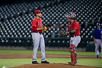 AZL Angels catcher Manuel Herazo (7) visits starting pitcher Jose Natera (87) on the mound during a game against the AZL Cubs on August 31, 2017 at Sloan Park in Mesa, Arizona. AZL Cubs defeated the AZL Angels 9-2. (Zachary Lucy/Four Seam Images)