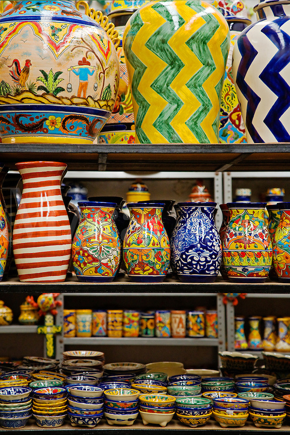 TALEVERA pottery including decorative vases, bowls and glasses on display in a DOLORES HIDALGO shop - GUANAJUATO, MEXICO