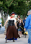 Lisa Schuette, with CASI, leads the Scallywaggers Pirate Pup Parade at the Brewery Arts Center, in Carson City, Nev., on Wednesday, Sept. 18, 2019.<br /> Photo by Cathleen Allison/Nevada Momentum