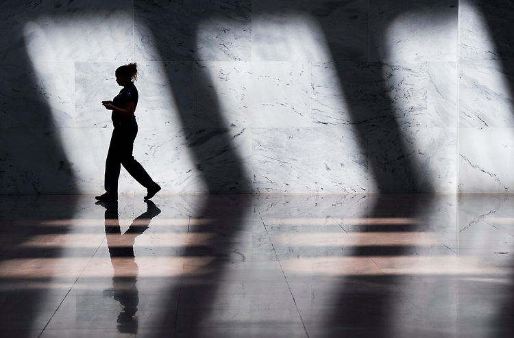 UNITED STATES - AUGUST 7: An Architect of the Capitol employee walks through the Hart Senate Office Building to during recess on Tuesday, Aug. 7, 2018. (Photo By Bill Clark/CQ Roll Call)