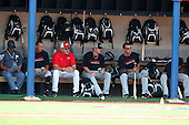 Coach Bill Bliss (red) sits in the dugout during practice for the Under Armour All-American Game at Les Miller Field on August 13, 2010 in Chicago, Illinois.  (Copyright Mike Janes Photography)