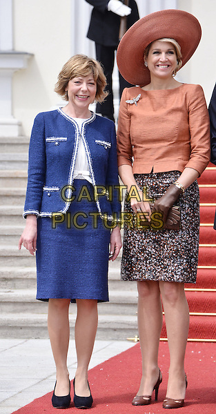 Daniela Schadt, Maxima <br /> Visit of King of The Netherlands Willem Alexander and Queen Maxima in Berlin, Germany. <br /> June 3rd 2013 <br /> full length orange hat blue  skirt  <br /> CAP/AAP<br /> &copy;AAP/Capital Pictures