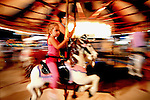 Stella Corber , 4, with her aunt Lisa Corbo-Vogler, of Windsor, enjoy a ride on the carousel, during the first night of the Windsor Locks annual carnival, Thursday evening, July 8, 2010.