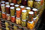 Jars of pickled goods for sale on display at stand at the Cicek Passag in Istanbul, Turkey