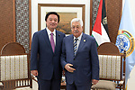 Palestinian President Mahmoud Abbas meets with chairman of the Foreign Relations Committee of the Japanese House of Representatives Kenji Wakamiya, in the West Bank city of Ramallah, August 18, 2019. Photo by Thaer Ganaim