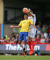 Taylor Moore (Bristol City) of England beats Richarlison of Brazil to the ball during the International match between England U20 and Brazil U20 at the Aggborough Stadium, Kidderminster, England on 4 September 2016. Photo by Andy Rowland / PRiME Media Images.