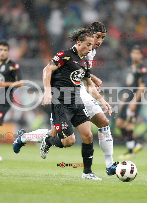 Real Madrid's Sami Khedira against Deportivo de La Coruna's Andres Guardado during La Liga match. October 03, 2010. (ALTERPHOTOS/Alvaro Hernandez)