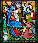 Nativity scene with blessed Virgin Mary and baby Jesus and shepherds, nineteenth century stained glass window at Holy Trinity church, Easton Royal, Wiltshire, England, UK unknown artist