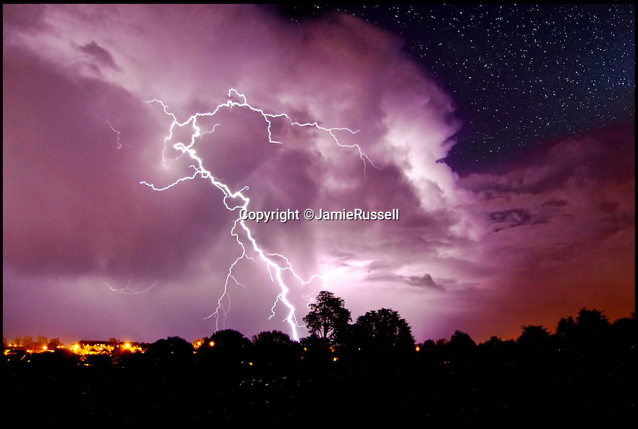 BNPS.co.uk (01202 558833)<br /> Pic: JamieRussell/BNPS<br /> <br /> ***Please Use Full Byline***<br /> <br /> A fork of lightning can be seen over the town of Shanklin, Isle of Wight.<br /> <br /> Stunning photographs have revealed a turbulent side to the normally genteel Isle of Wight.<br /> <br /> The seemingly benign south coast holiday destination has been catalogued over a stormy year by local photographer Jamie Russell, and his astonishing pictures reveal the dramatic changes in weather that roll across the UK in just 12 months.<br /> <br /> Lightning storms, ice, floods, gales and blizzards have all been captured by the intrepid photographer who frequently got up in the middle of the night to capture the climatic chaos.<br /> <br /> Looking at these pictures prospective holidaymakers could be forgiven for thinking twice about a gentle staycation on the south coast island.