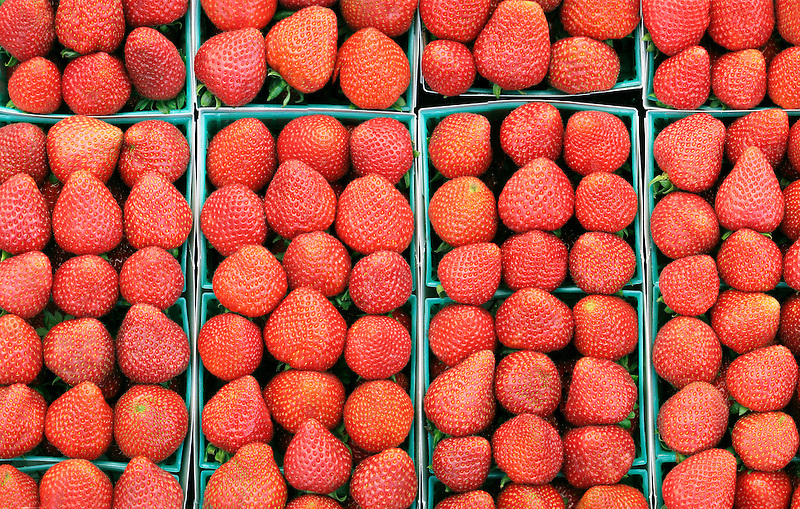 Lined up Strawberries at farmer's market. Los Angeles, California