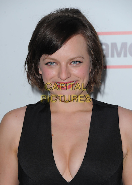 "Elisabeth Moss.""Mad Men"" Season Six Los Angeles Premiere held at the Director's Guild of America, West Hollywood, California, USA.     .March 20th, 2013.headshot portrait black sleeveless low cut neckline cleavage .CAP/DVS.©DVS/Capital Pictures."