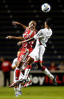 Chicago Fire forward Andy Herron (26) and New England Revolution defender James Riley (16) battle for a header.  The Chicago Fire defeated the New England Revolution 2-1 in the quarterfinals of the U.S. Open Cup at Toyota Park in Bridgeview, IL on August 23, 2006...