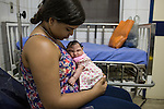 RECIFE, BRAZIL - JANUARY 8: Cleane Serpa, 18, holds her one-month-old cousin, Maria Eduarda, who was born with microcephaly, recovers from chickpox at the Hospital Universit&aacute;rio Oswaldo Cruz, in Pernambuco's capital of Recife, in Brazil, on Friday, Jan. 8, 2016. The parents of Maria Eduardo, who are extremely poor, did not want her so Cleane and an aunt will raise the baby.<br /> <br /> The mosquito-borne Zika virus continues to spread in Brazil, alarming health officials and expecting mothers that their babies will be born with abnormal brain development called microcephaly. While researchers have yet to make a connection, Brazil has the highest number of babies born with mircocephaly - the most cases in Recife, Pernambuco - from mothers who tested positive to the Zika virus. There are about 3,530 suspected cases of zika-related microcephaly in Brazil.