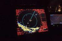 Die Sea Watch-2 Crew war am Freitag den 21. Oktober 2016 in den fruehen Morgenstunden waehrend ihrer 13. SAR-Mission vor der libyschen Kueste zu einer Position ausserhalb der 12 Meilenzone gerufen worden. Es war ein Fluechtlingsschlauchboot gesichtet worden. Als die Sea Watch-2 dort eintraf sah sie ca. 150 Menschen zusammengepfercht in einem ueberfuellten Schlauchboot sitzen. Eine Versorgung der Menschen auf dem Fluechtlingsschlauchboot mit Rettungswesten durch die Rettungs Boote der Sea Watch-2 wurde von der libyschen Kuestenwache unterbunden. Ein Soldat der Kuestenwache enterte das Schlauchboot vom Bug und machte sich dann an dem Aussenbordmotor zu schaffen. Auf dem Weg dahin schlug und trat er die Gefluechteten ein. Nach einigen Minuten entfernte sich das Boot der Kuestenwache. Dann verlor der Bug des Schlauchbootes seine Luft und es brach Panik bei den Gefluechteten aus. Sie sprangen in das Wasser und versuchten zum Schiff Sea Watch-2 zu gelangen. Die Crew warf ihnen Schwimmwesten und Rettungsringe zu, die Besatzungen der Rettungsboote der Sea Watch-2 zogen Menschen aus dem Meer, dennoch sind bis zu 30 Menschen ertrunken. Vier Ertrunkene konnten von der Sea Watch geborgen werden.<br /> Im Bild: Der Rardarschirm auf der Bruecke der Sea Watch-2 waehrend ihres Einsatzes am Freitagmorgen um 2.30 Uhr. Das Radarbild zeigt eindeutig, dass der Vorfall in internationalem Gewaesser stattfand.<br /> 21.10.2016, Mediterranean Sea<br /> Copyright: Christian-Ditsch.de<br /> [Inhaltsveraendernde Manipulation des Fotos nur nach ausdruecklicher Genehmigung des Fotografen. Vereinbarungen ueber Abtretung von Persoenlichkeitsrechten/Model Release der abgebildeten Person/Personen liegen nicht vor. NO MODEL RELEASE! Nur fuer Redaktionelle Zwecke. Don't publish without copyright Christian-Ditsch.de, Veroeffentlichung nur mit Fotografennennung, sowie gegen Honorar, MwSt. und Beleg. Konto: I N G - D i B a, IBAN DE58500105175400192269, BIC INGDDEFFXXX, Kontakt: post@christian-ditsch.de<b