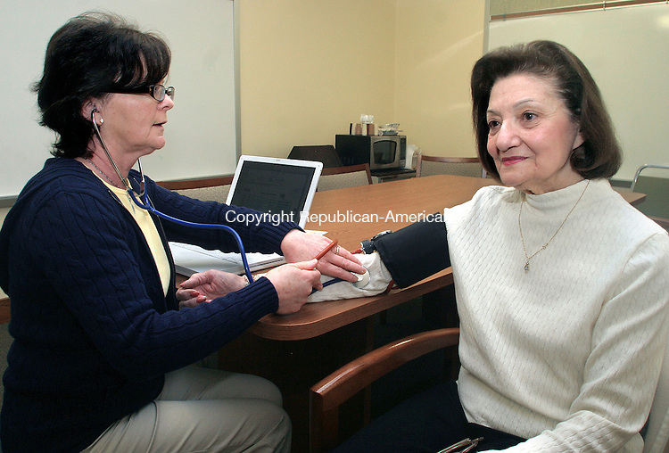 SOUTHBURY CT.-11 MARCH 2010-031110DA11- Pomperaug District Department of Health, Betsey Thibodeau, RN, left, checks the blood pressure of Genevieve Shandor at the Southbury Senior Center Thursday.<br /> Republican-American  Darlene Douty