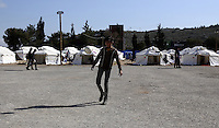 Pictured: A young boy plays football at the campsite Friday 26 February 2016<br /> Re: Hundreds of refugees have been given temporary shelter at the Stefanakis Army Camp in the Schisto area of Athens, Greece.